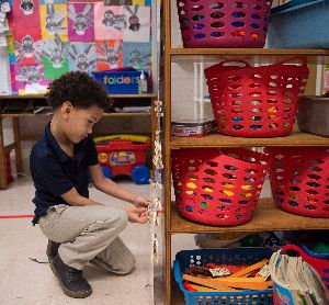 Boy playing classroom